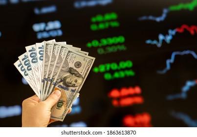 American dollar and Turkish lira on woman's hand and stock market screen, money chart background - Shutterstock ID 1863613870