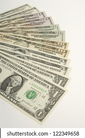 American dollars arranged over white background
