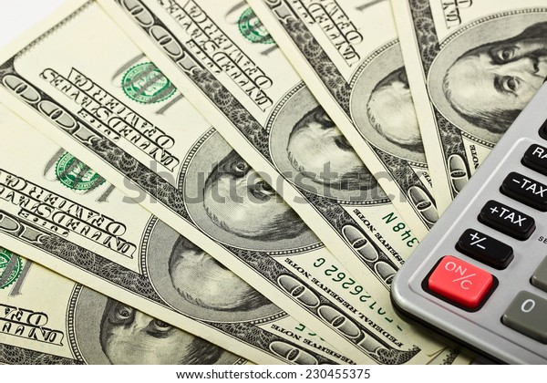 American dollars as a background and calculator