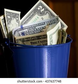 American dollars in a bucket