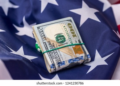 American dollars in bunch on national flag