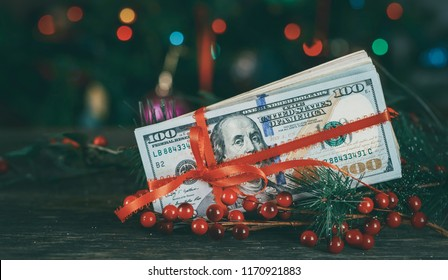 American dollars as a Christmas gif t or a Christmas spending concept