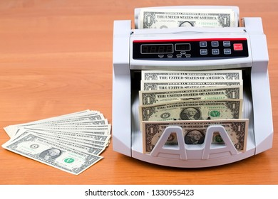 American dollars in a counting machine
