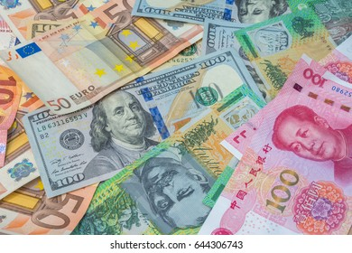 American dollars, Euro money, Australian dollars and Chinese yuan as currency banknotes background.