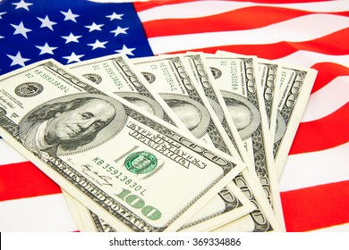 American dollars and flag. Stock images. Top image