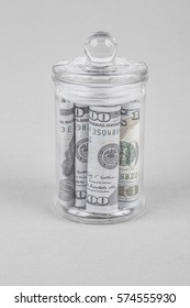 American dollars in a jar for saving