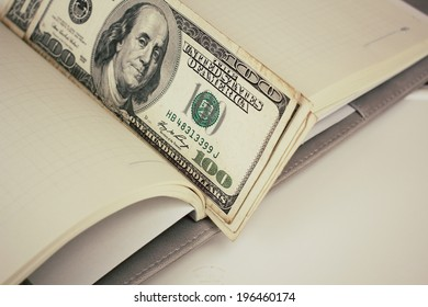 American dollars money and book