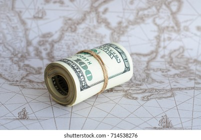 American dollars on the world map.
