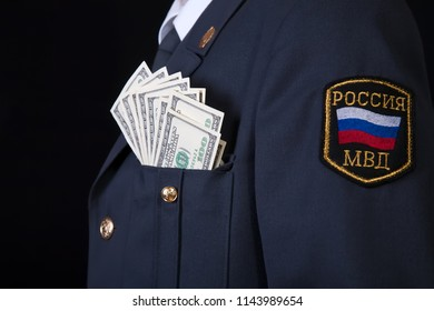 American dollars in a pocket of Russian Police officer, bribe and corruption concept