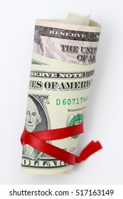 American dollars and red ribbon on Holiday/USA cash money
