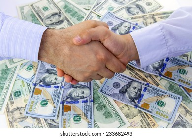 American dollars. Shaking hands. Business