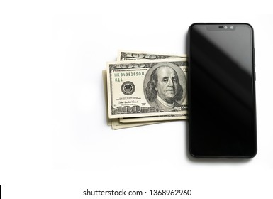 American dollars and smartphone isolated on white. Mobile payments concept