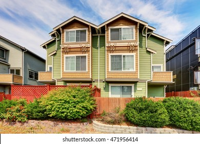 American duplex house for two families. Green exterior paint. Northwest, USA