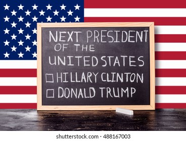 American election concept with flag and handwriting text next president of United States Donald Trump Hillary Clinton written in chalkboard background, close up
