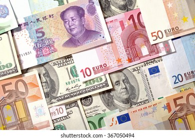 American, European and Chinese banknotes background. Dollars, Euro and Yuan currencies