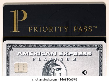 American Express (Amex) Platinum card and a black Priority Pass card stacked on a white table. These get you ready for luxurious travels! Photographed in Espoo, Finland May 2019.