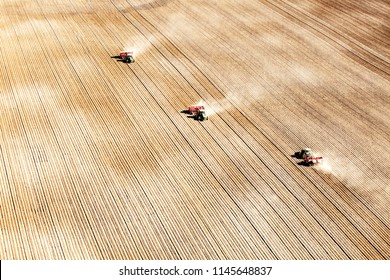 American Falls, Idaho, USA Apr. 17, 2015 An aerial view of 3 tractors planting potatoes in the fertile farm fields of Idaho.