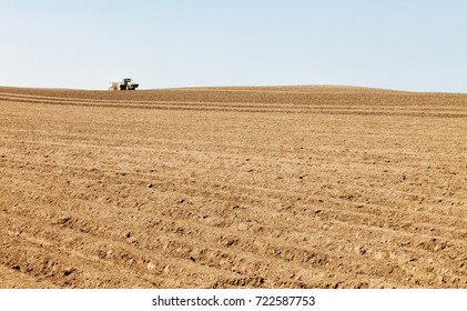 American Falls, Idaho, USA Apr. 17, 2015 A tractor in the field planting potatoes
