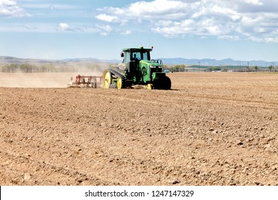 American Falls, Idaho, USA May 2, 2012 A tractor in the plowing a farm field in preparation for spring planting.