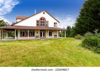 American farm house exterior with wraparound deck