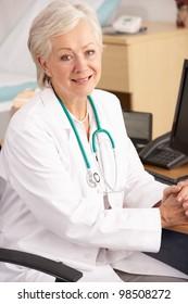 American female doctor sitting at desk