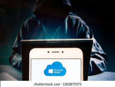 American file hosting and cloud computing service owned by Microsoft, Azure, logo is seen on an Android mobile device with a figure of hacker in the background.