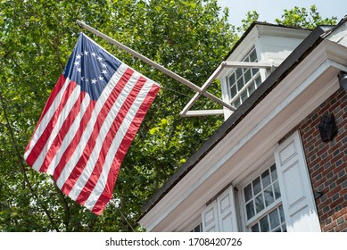 American flag with 13 stars on the exterior of the Betsy Ross House on Arch Street in Philadelphia, Pennsylvania on July 6, 2019.