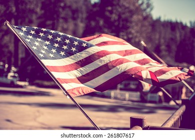 American Flag. 4th of July City Decoration. Vintage Grading.
