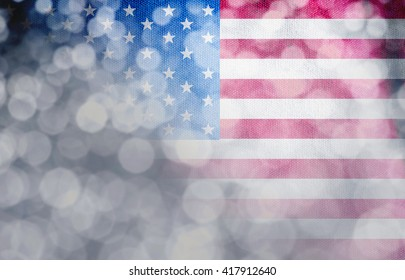 The American flag with abstract lighting for independence day background