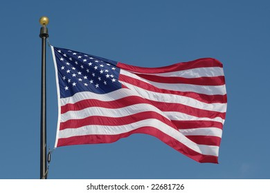 American flag against blue sky. See more flags in my portfolio.
