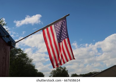 American Flag against a blue sky. Beautiful summer day.