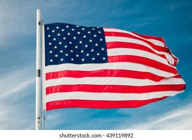 American flag against bright blue sky