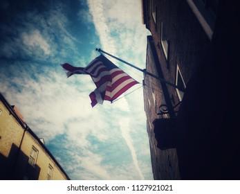 American flag against a cloudy sky