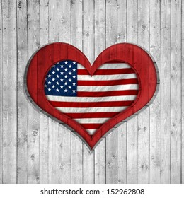 American flag background of wood heart-shaped
