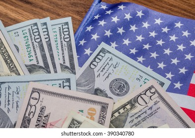 American flag with banknotes and coins