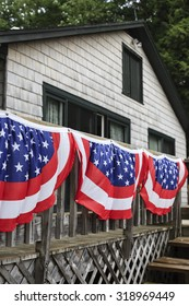 American flag banners on a cabin deck