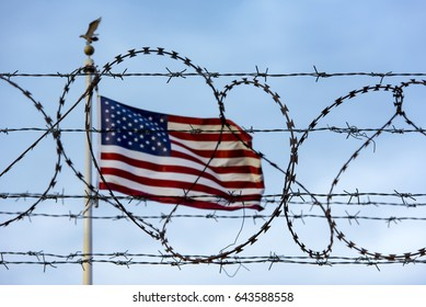 American flag and barbed wire, USA border