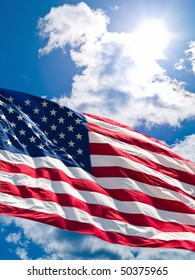 American Flag Before a Cloudy Blue Sky