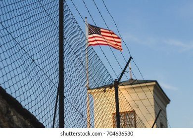 American flag behind a fence