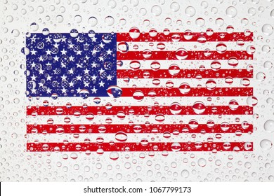 American flag behind a glass covered with rain drops. Patriots day, memorial weekend, veterans day, presidents day, independence day background.