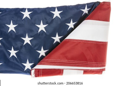 American Flag being folded with white background