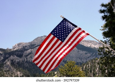 American flag billowing in the winter air
