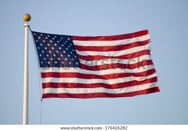 American flag blows in the wind by the ocean in Newport, Rhode Island