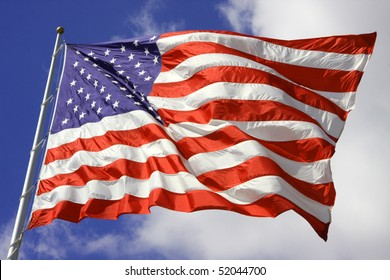 American Flag blows in the wind on the 4th of July.