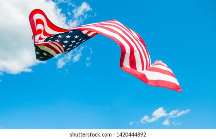 American flag in blue sky background. United States holiday