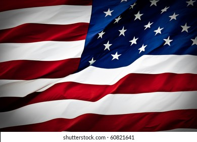 an american flag boldly flying in the wind