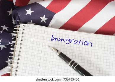 American flag and a booklet with the word Immigration