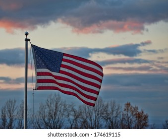 American flag in a breeze at dusk on Virginias Blue Ridge