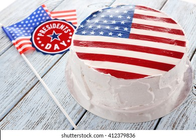 American flag cake, on wooden background. President's day concept.