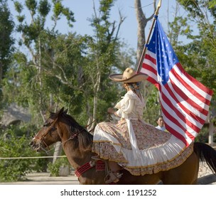 american flag carried by cowboy